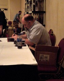 Larry Correia signing books in the Dealers' Room, 7-12-14