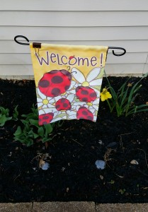 Yellow Welcome banner with ladybugs at the Author Chronicles' headquarters