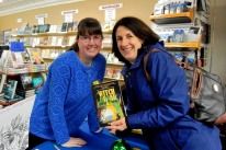 39 - Kerry Gans and Marie Lamba holding a copy of The Witch of Zal at the book launch at The Doylestown Bookshop, 3-19