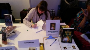 Kerry Gans of Author Chronicles signing copies of her middle grade book The Witch of Zal