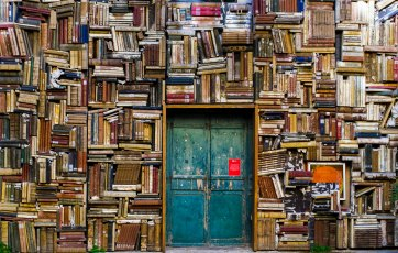 The Author Chronicles, Top Picks Thursday, books in various positions filling shelves around door, used books
