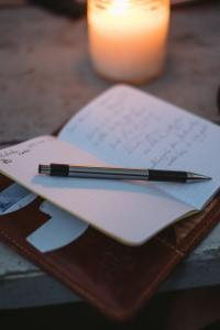 The Author Chronicles, Top Picks Thursday, J. Thomas Ross, notebook with pen and candle